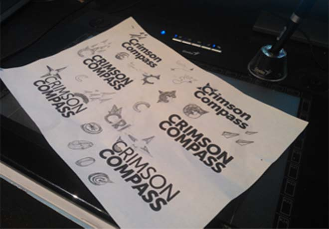 sketch of logo concepts for Crimson Compass